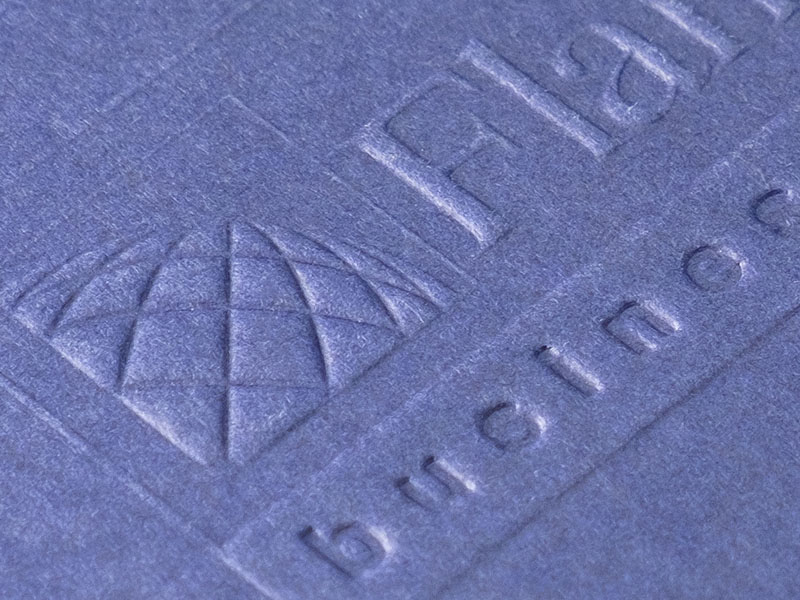 Blind embossing a blue cover paper.