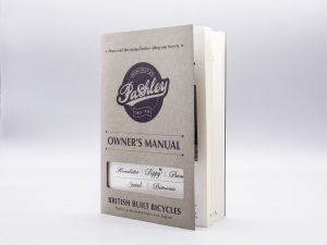 Pashley Owners Manual with 'one size fits all' die cut aperture cover.